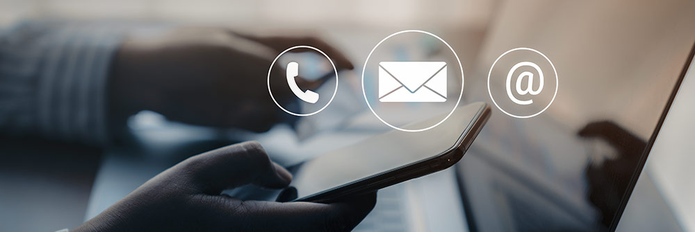 person holding cell phone with phone, email and mail icons